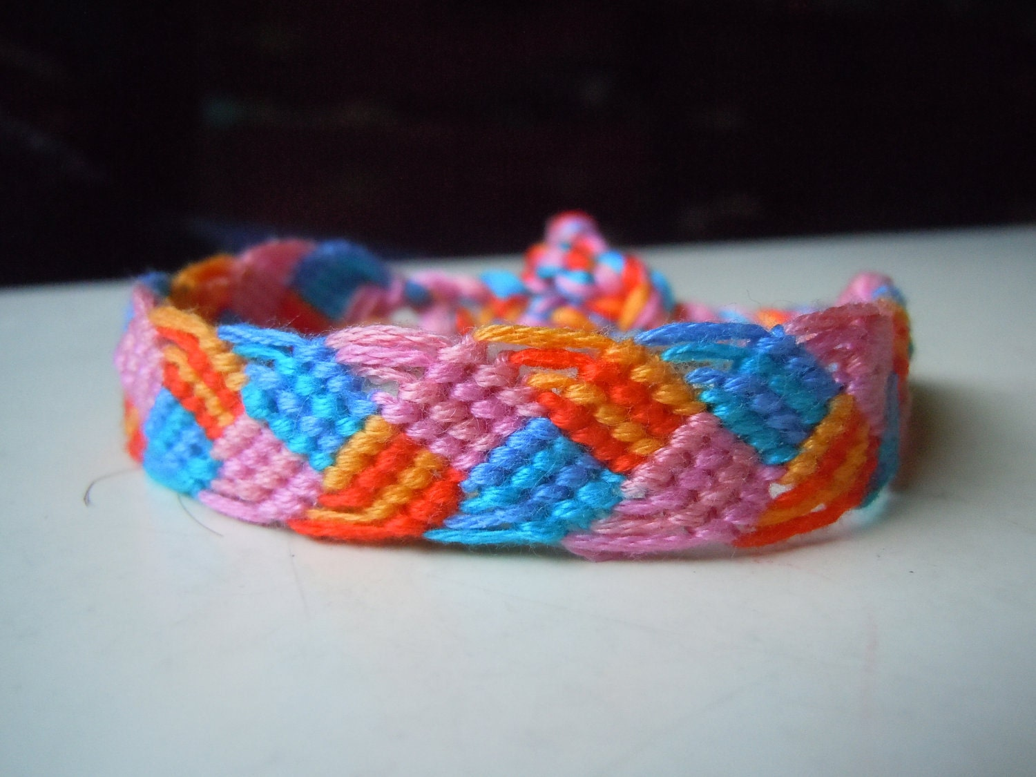 braided leaves friendship bracelet orange blue by