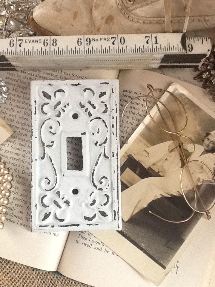 metal wall decorlight switch platecast by alacartcreations