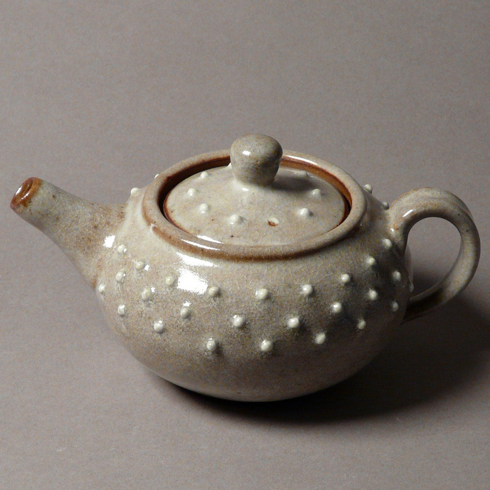 Hobnail teapot set with four simple cups in shino