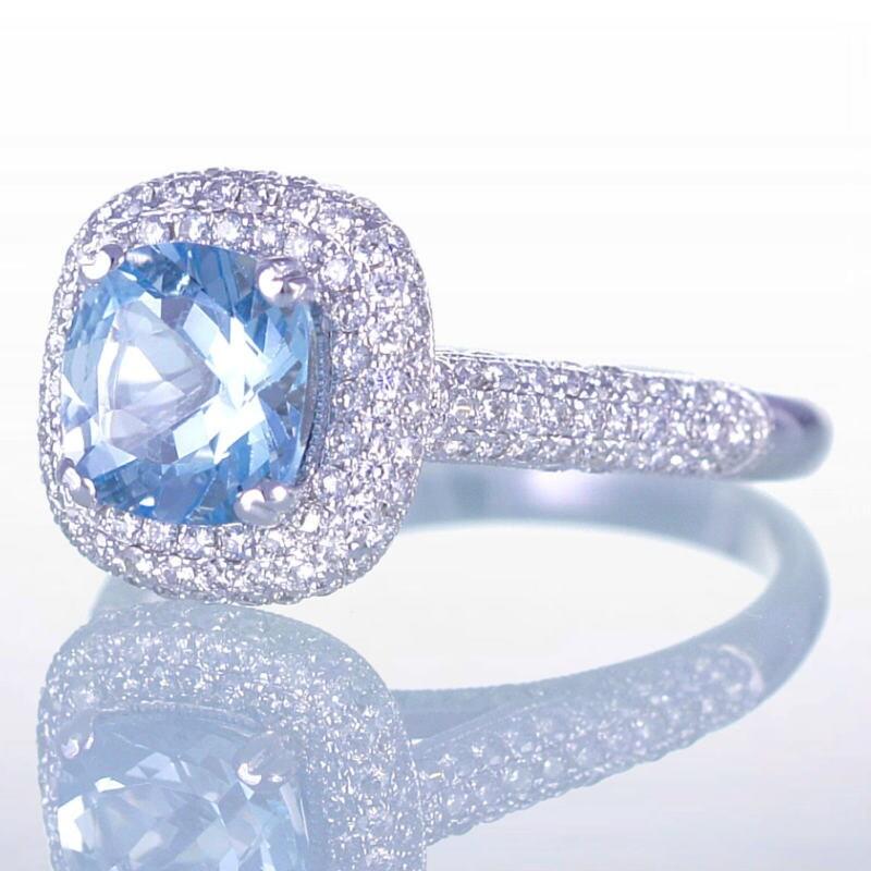 cushion cut aquamarine engagement ring with filigree by