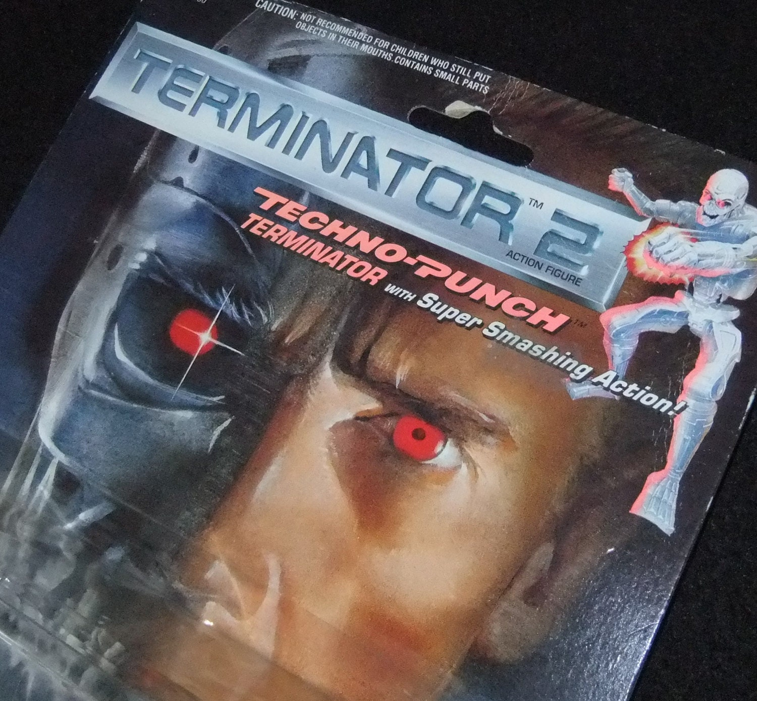 Terminator 2 1991 TechnoPunch Terminator Arnold Schwarzenegger action figure carded by Kenner