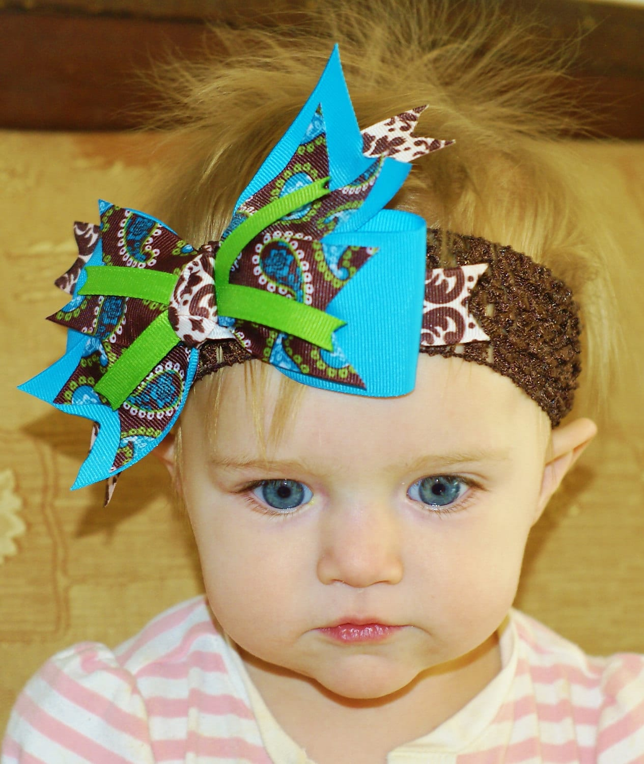 Baby headbands and girls hair bows just got a lot classier with our upscale styling and distinct quality craftsmanship. Our products are hand assembled in the USA with top quality materials that are rarely seen with ordinary crafters, hobbiests, or local businesses - who often buy premade from China or .