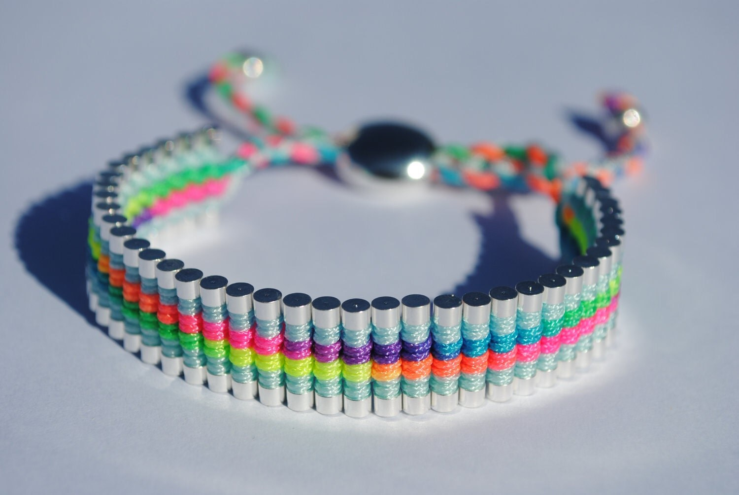 Link Friendship Bracelet. Silver Plated with Woven Neon Macrame and blue trim. (Similar to Links of London Brand)