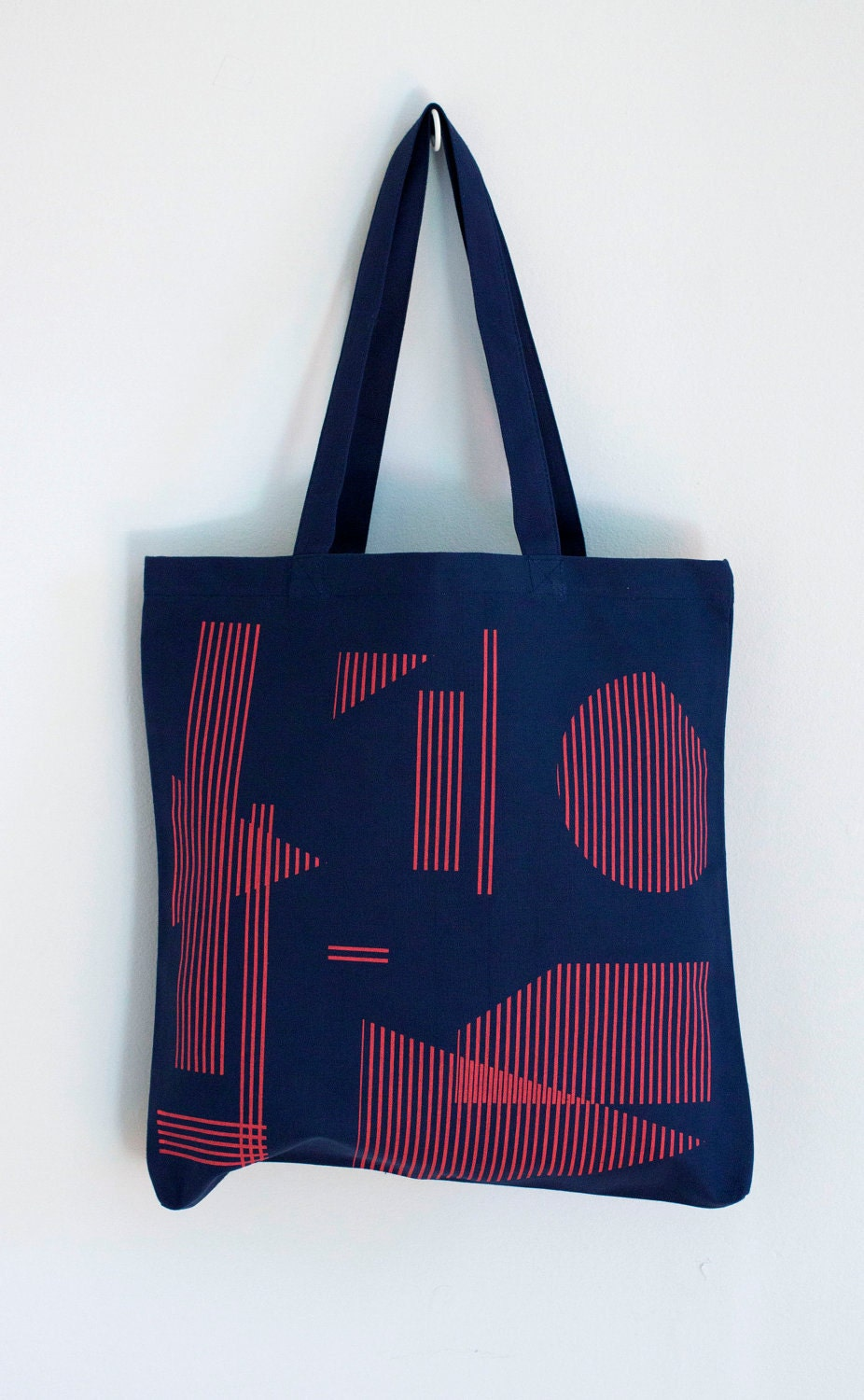 Floating Shapes tote in red on navy blue
