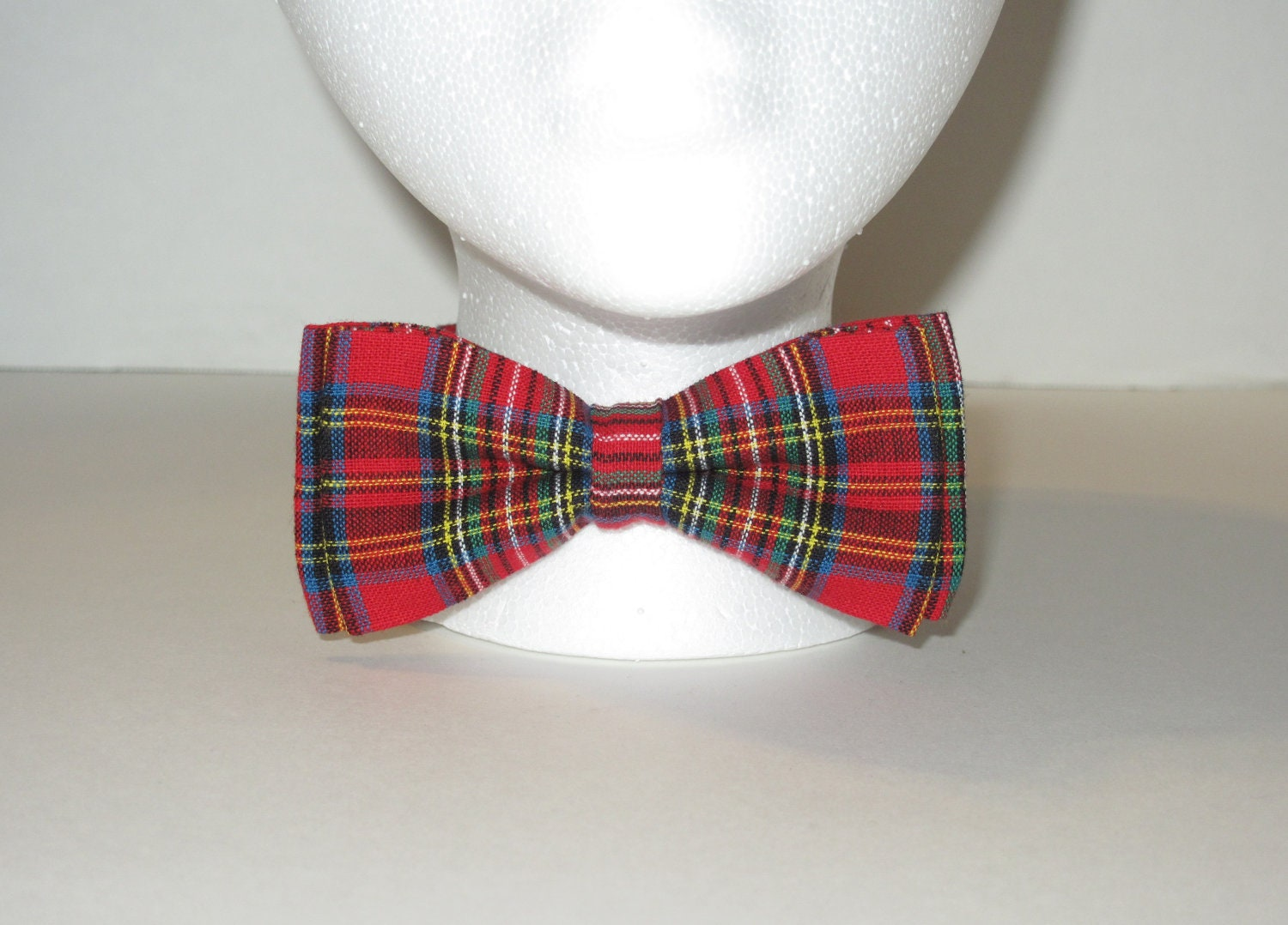 Child's Boy's Wool Tartan Bow Tie made in Scotland in authentic custom or in-stock tartans. Dinky little boys version of the adult tartan bow tie. Our boys wool tartan bow ties are available in over tartans and made in Scotland from % pure wool.