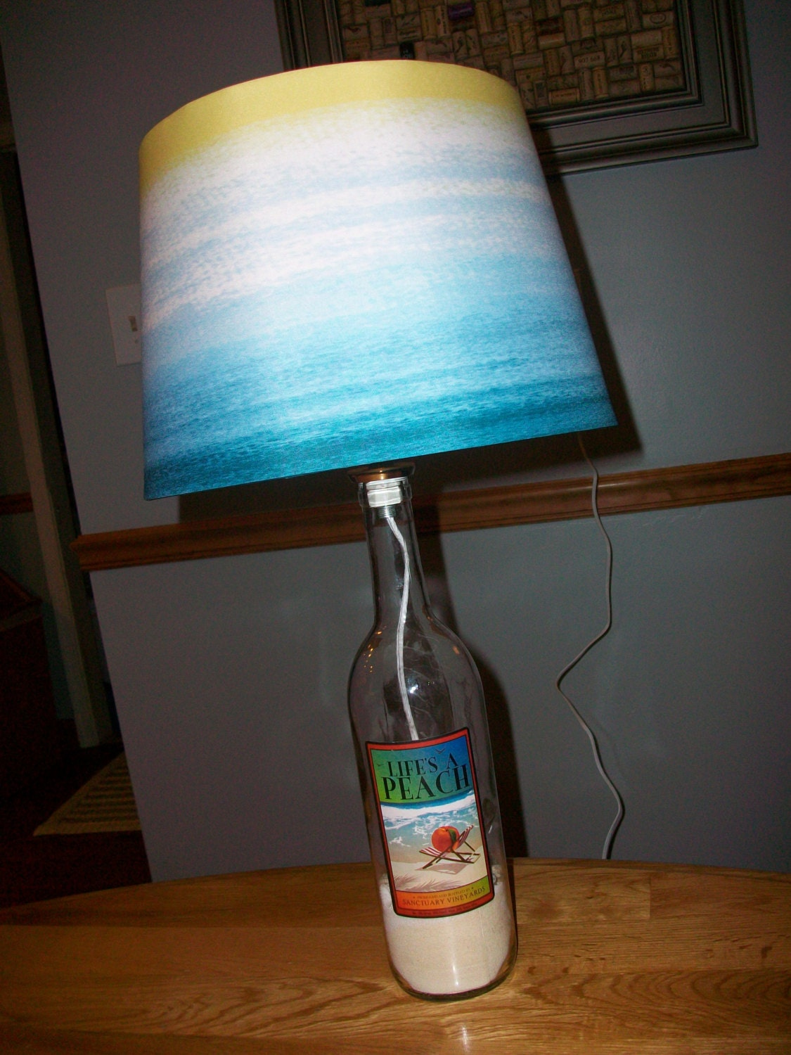 life 39 s a peach wine bottle lamp with lamp by saltwaterandwine. Black Bedroom Furniture Sets. Home Design Ideas