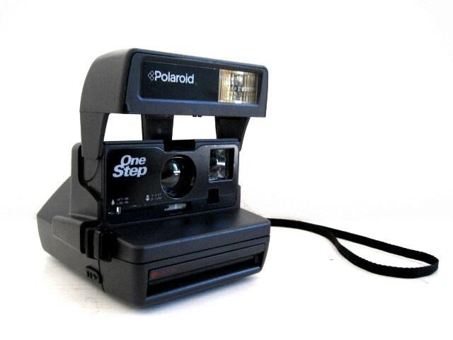 Load 600 film in polaroid instant camera