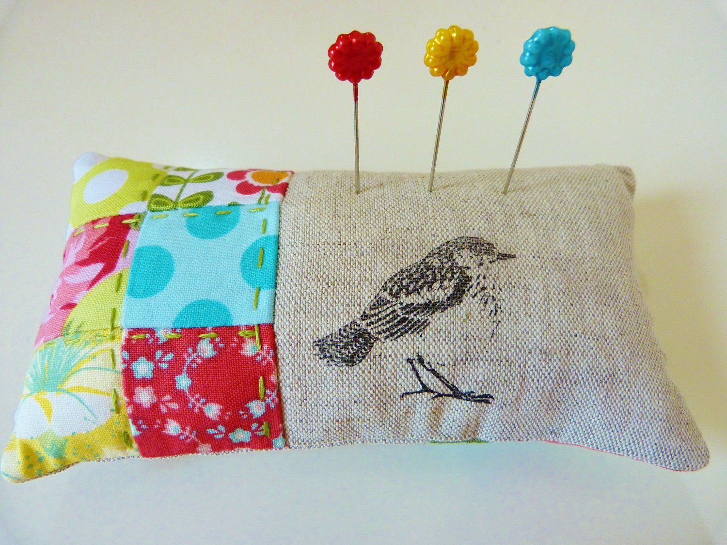 Pincushion in red, green, yellow and aqua patchwork with linen in a bird theme READY TO SHIP