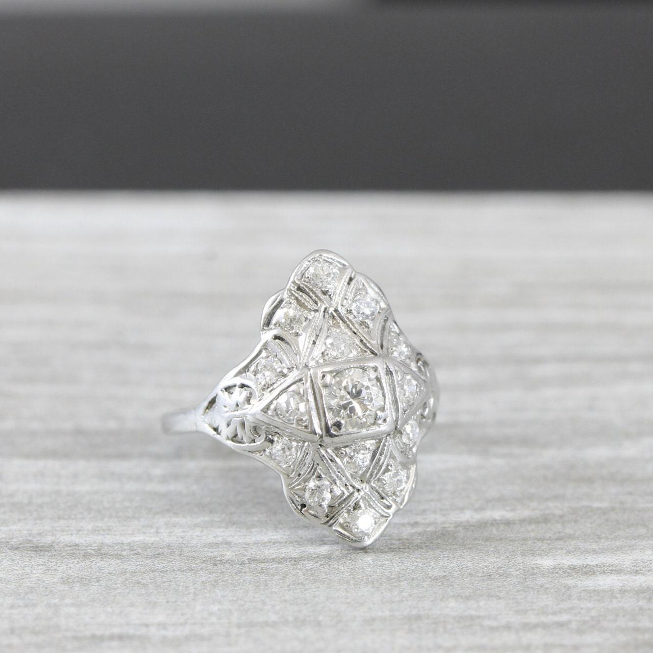 Art deco 1920s diamond cluster ring in platinum handmade antique