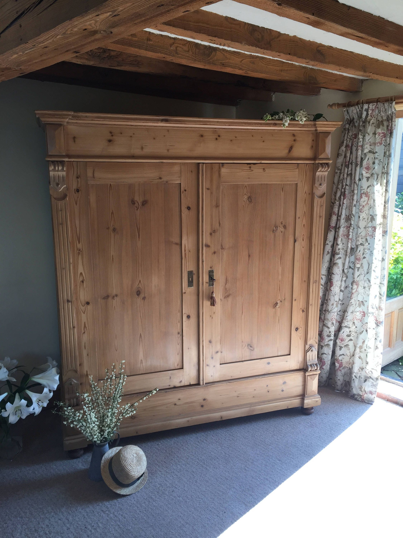 Antique pine doubletriple wardrobe with shelf.