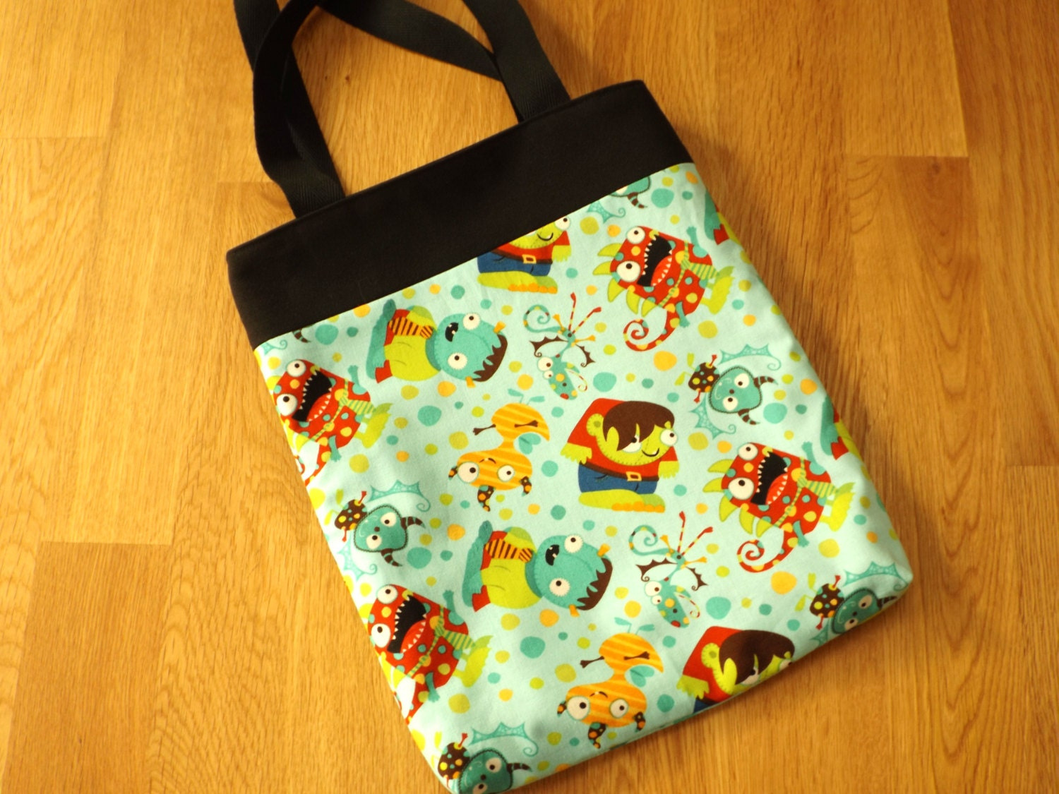 Halloween trick or treat bag  tote. Main fabric light blue and decorated with monsters