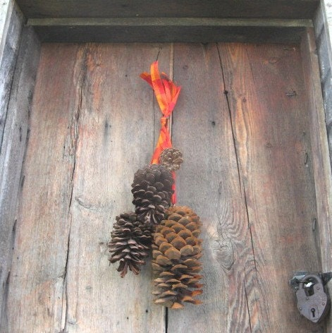 Pine cone ribbons door or wall wreath by thekeepershouse for Pine cone door decoration