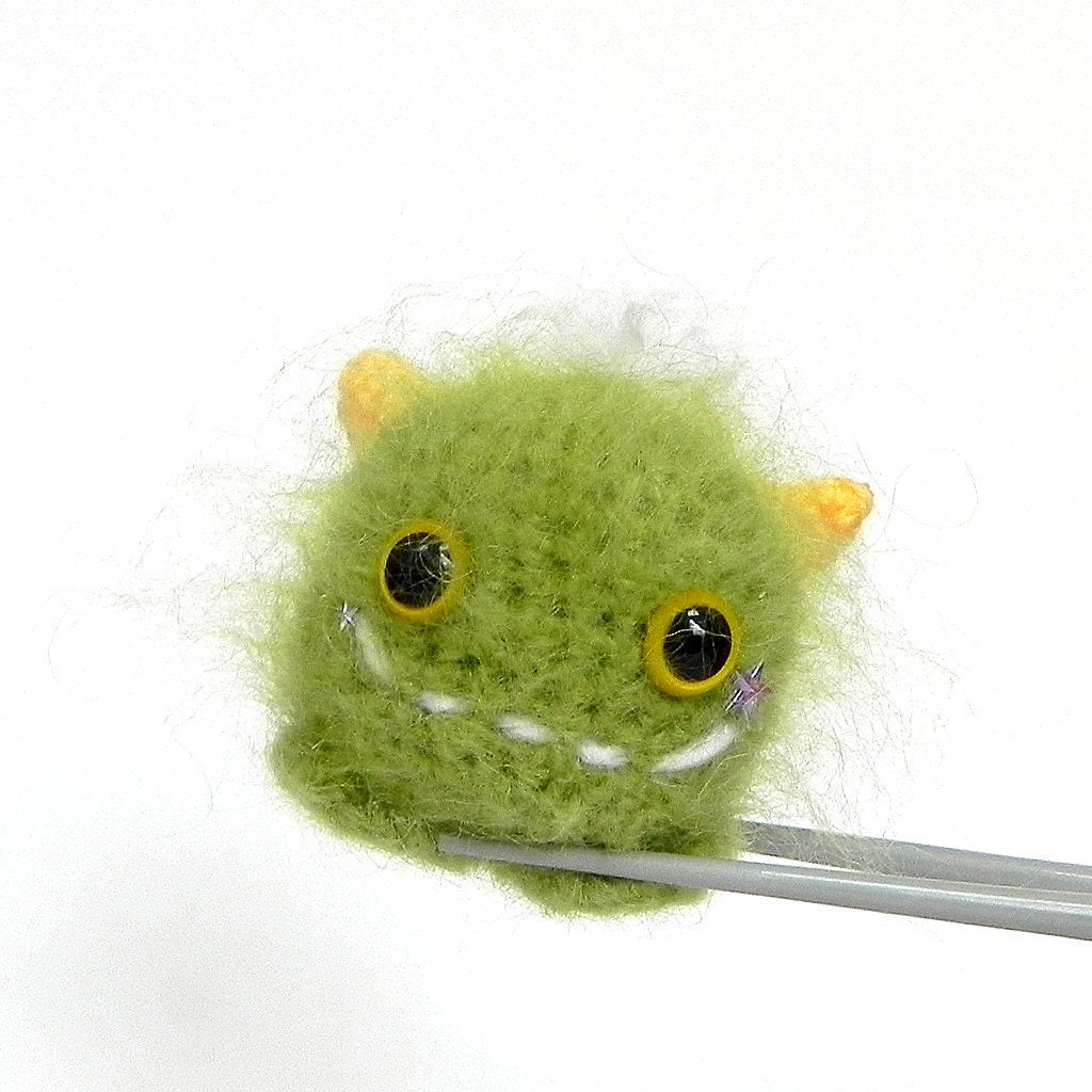 Amigurumi green furry monster MochiQtie crochet by MochiQtie