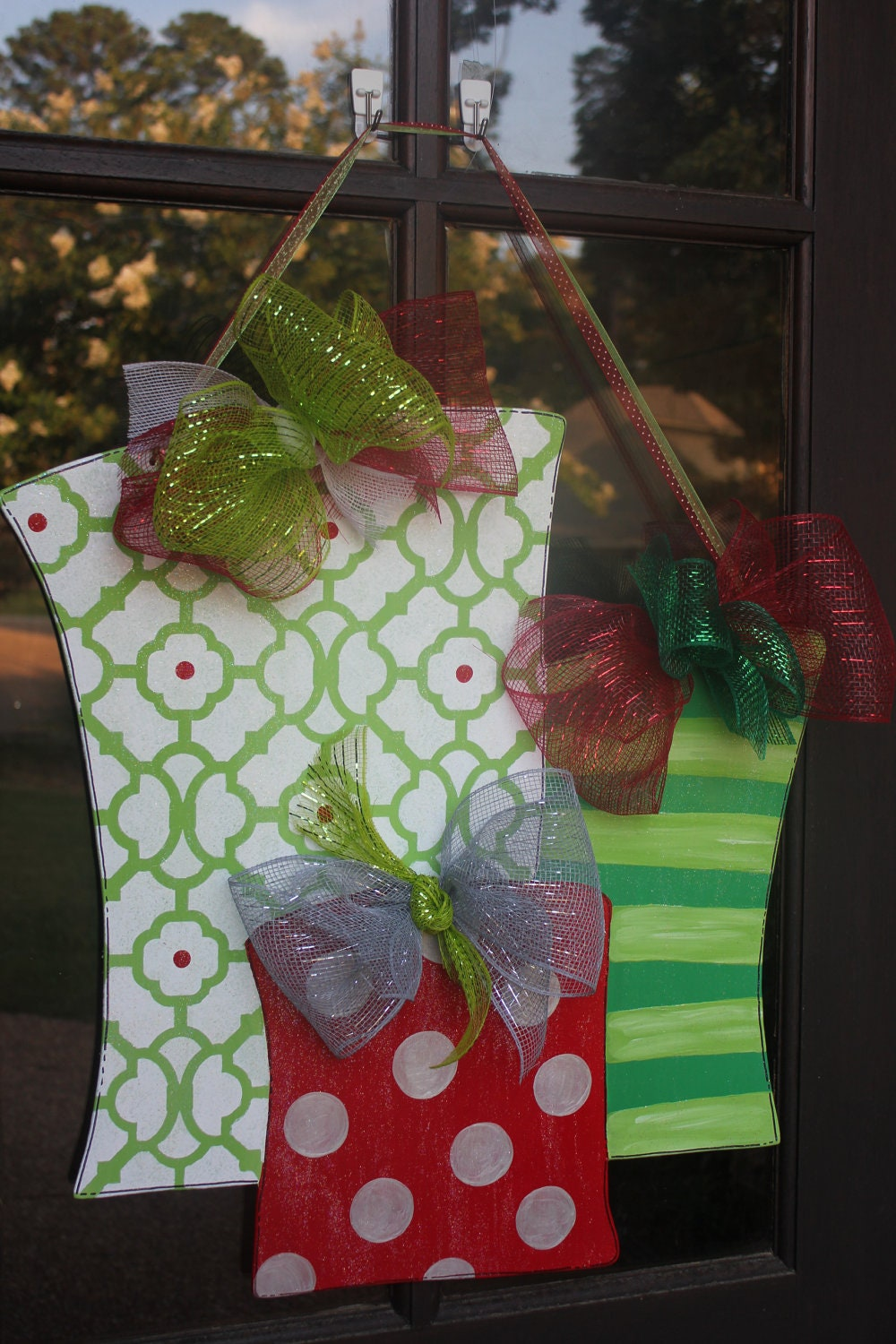 Items similar to wood christmas presents door hanger on etsy