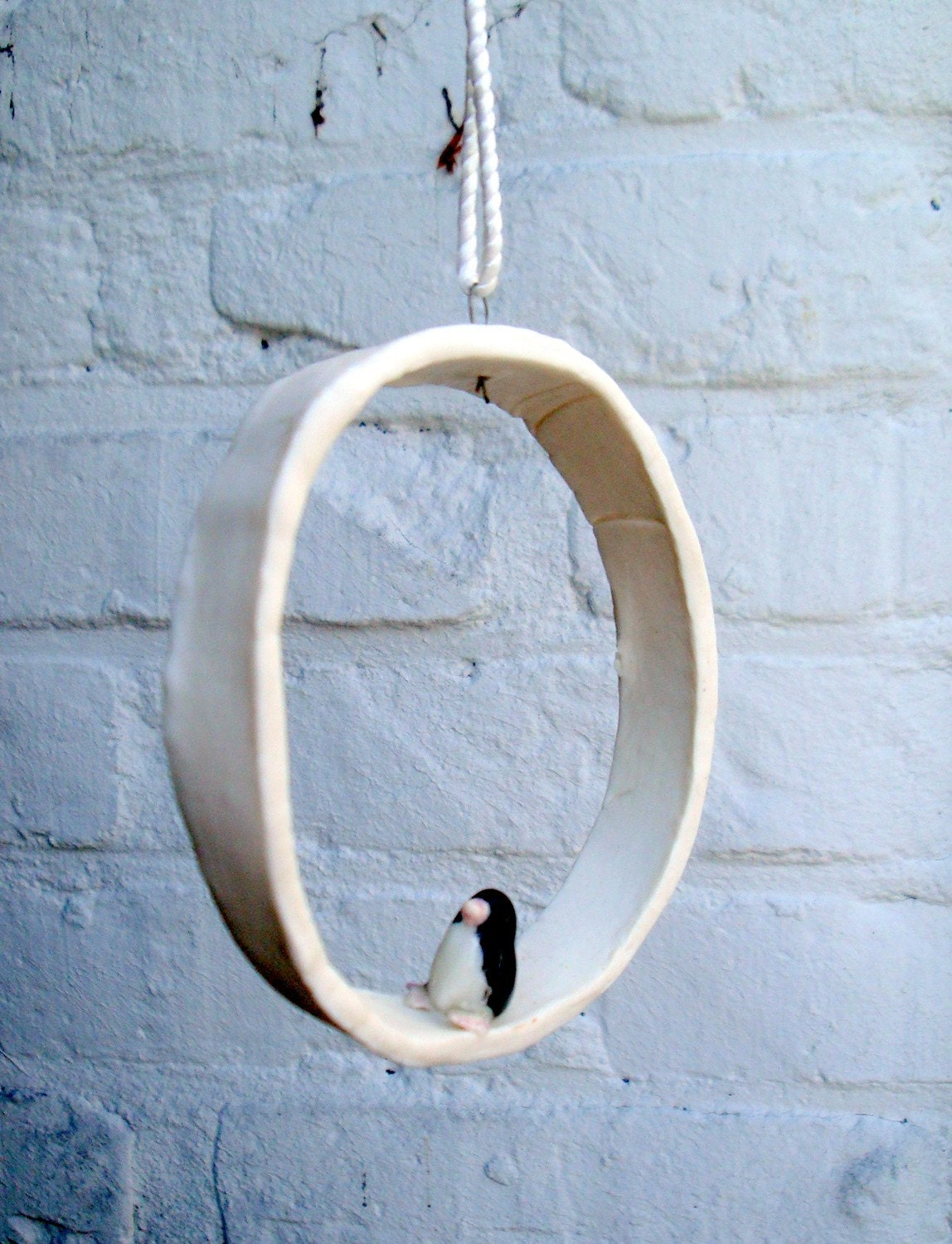 Window hanger with a penguin in porcelain - TwoTreesWorld