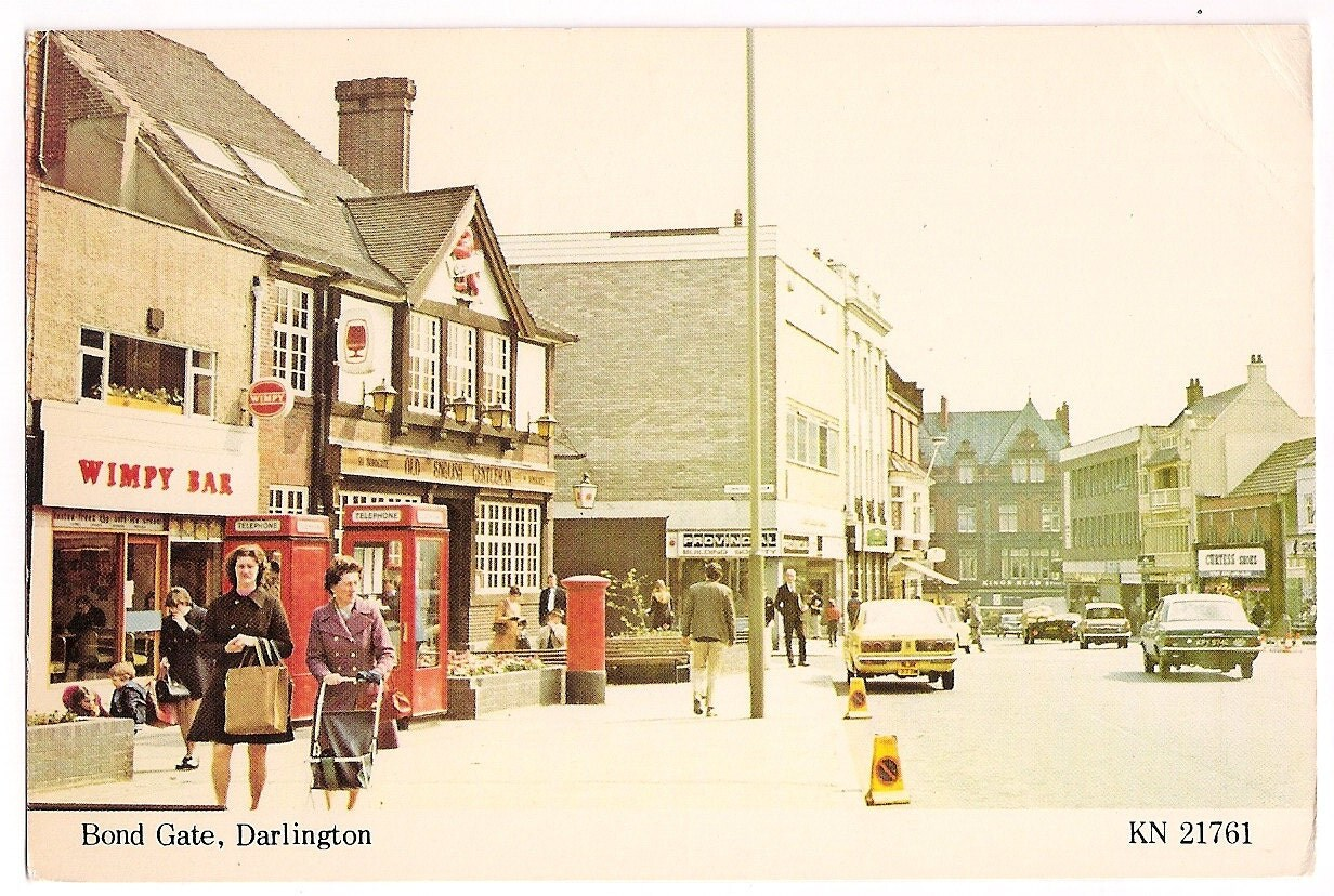 Bond Gate Darlington County Durham England Vintage Postcard, Retro Shopping Scene with Old Cars, English Souvenir - VintagePackRat