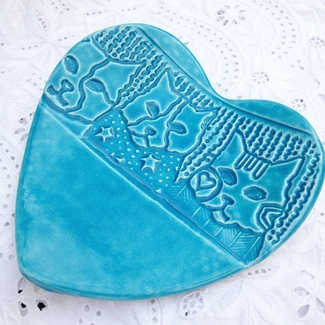 Ceramic turquoise heart shaped dish with cat face design