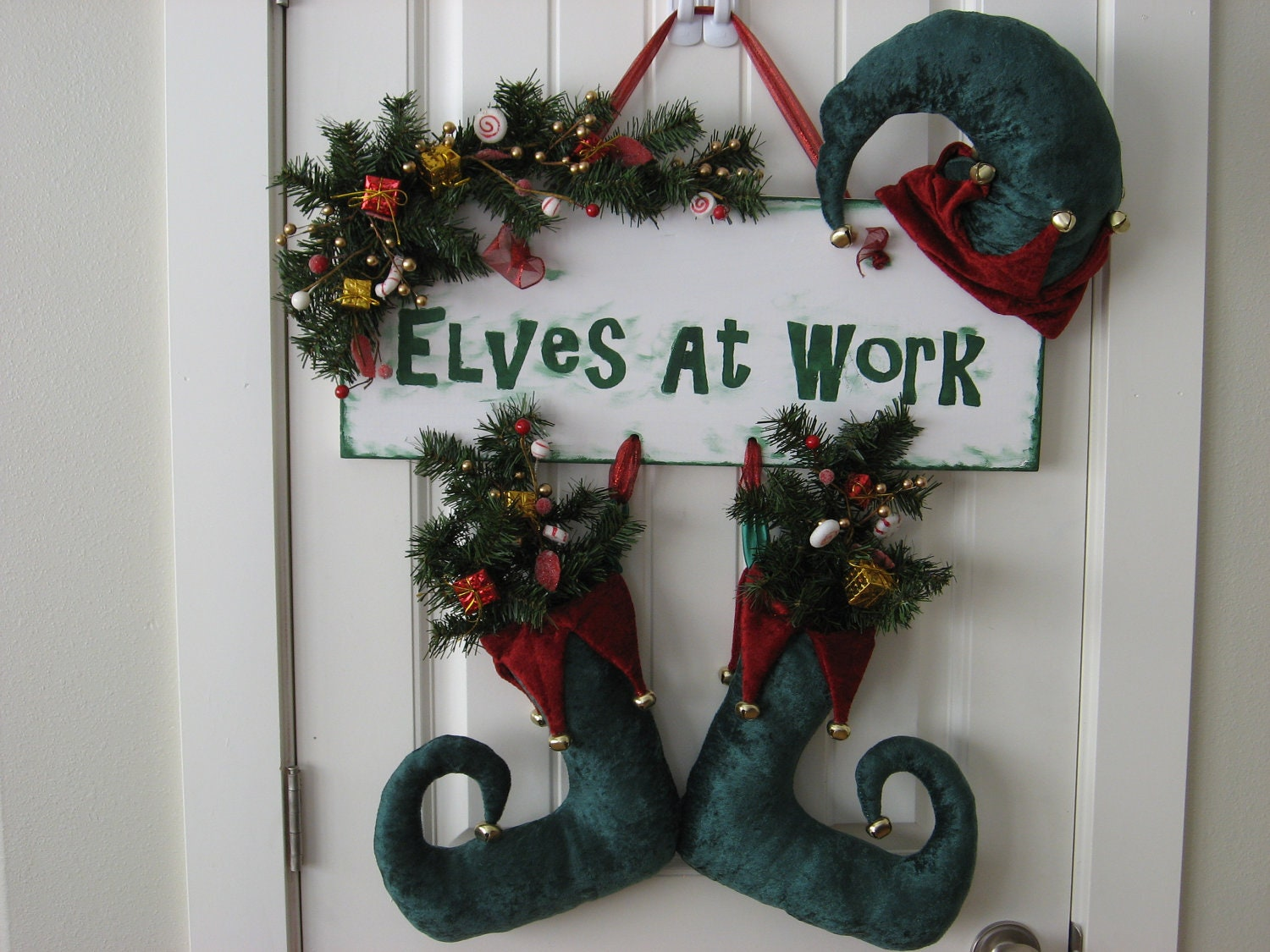 Handmade Christmas Decoration Door Hanger Elf Hat and Boots. Elves At Work