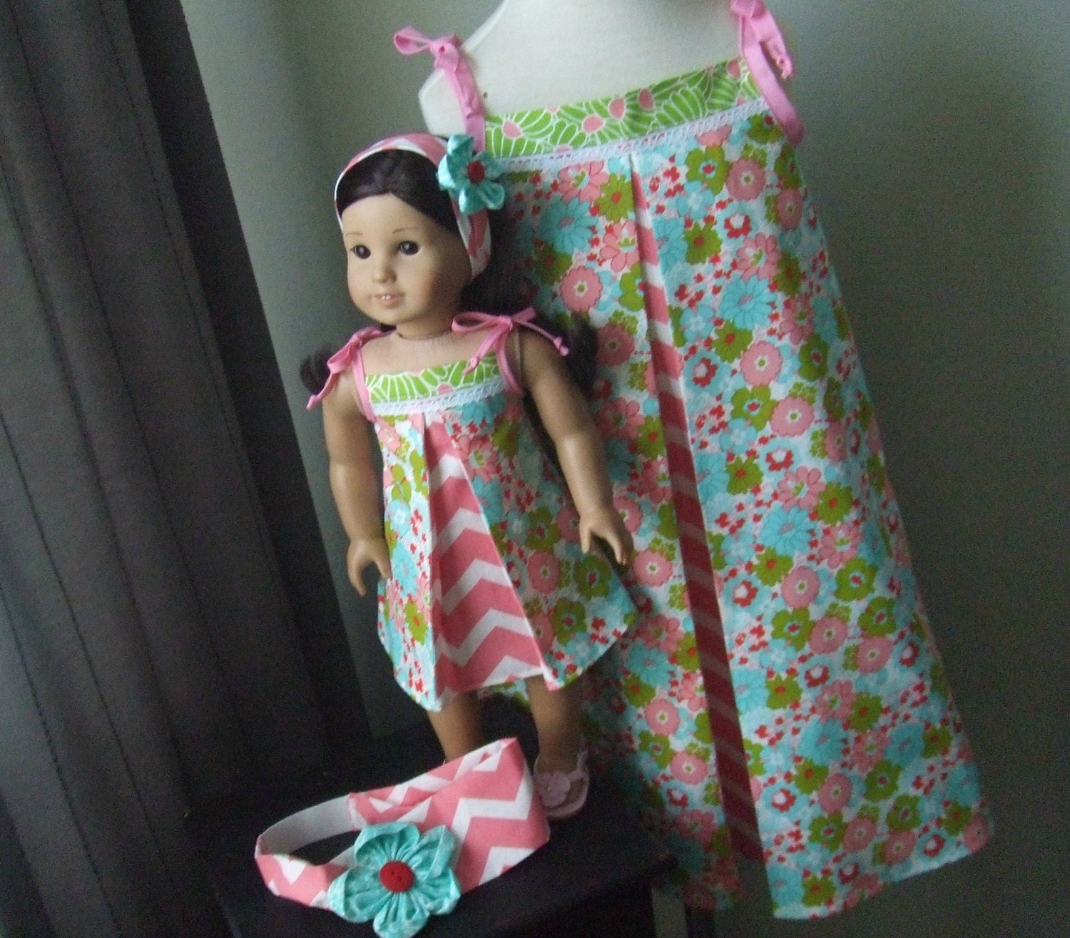 I don't make dolls, but my 2 girls each have American Girl dolls, and I have made several matching dresses, nightgowns & PJ's. I have made matching doll/girl PJ's for my nieces, and they all .