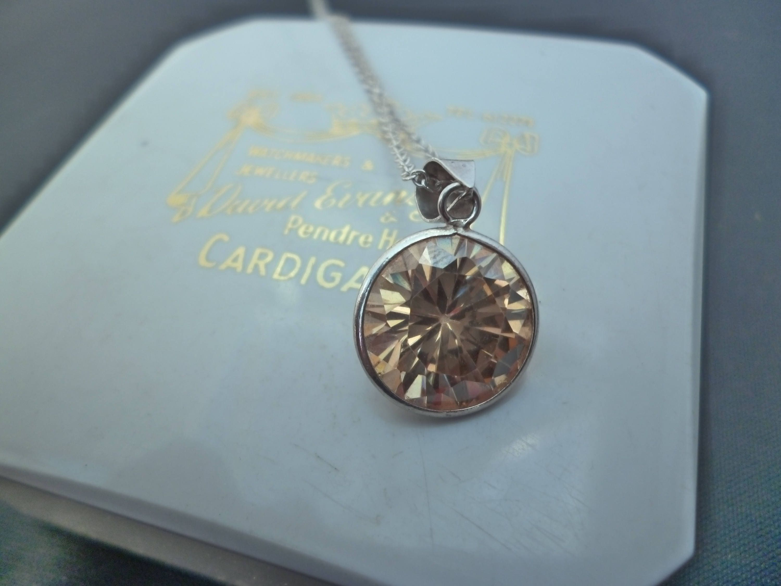 A stunning sparkly orange topaz pendant necklace  925  sterling silver  Marked 925  16 necklace