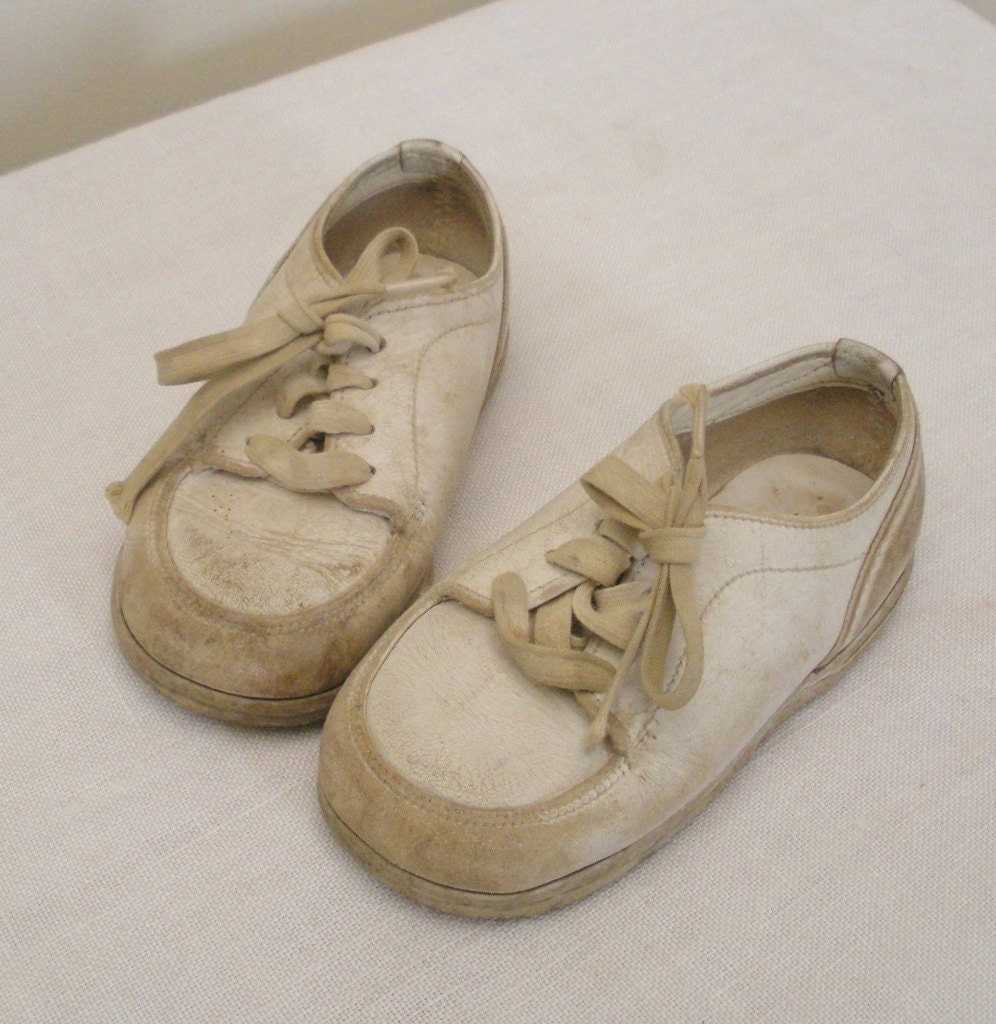 vintage well worn white leather baby shoes by