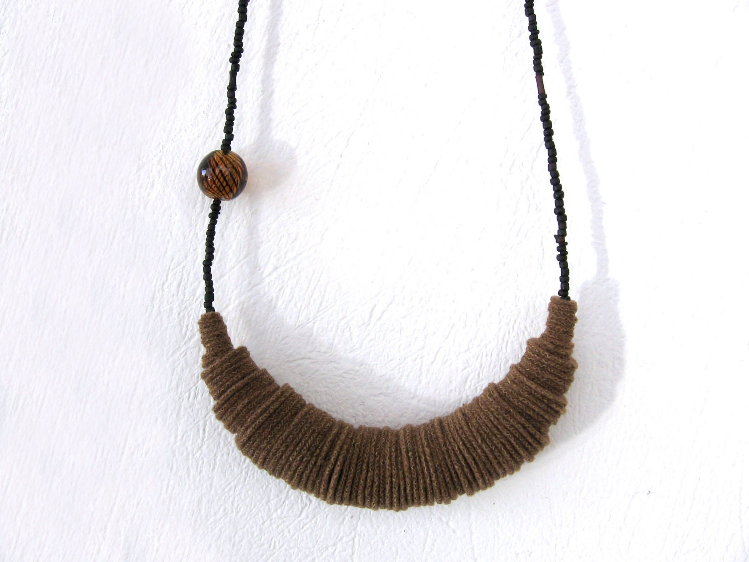 geometric chunky brown felt necklace with a glass bead - minimal contemporary jewelry