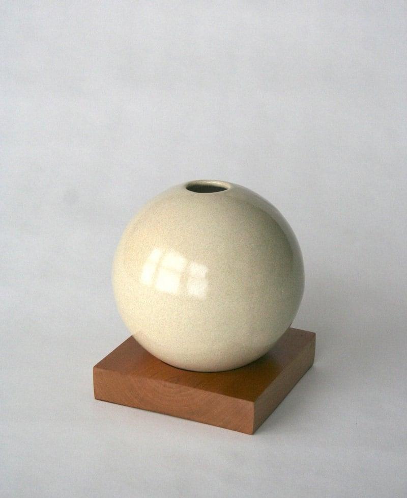 beige ceramic vase with solid cherry base - snicholsstudio