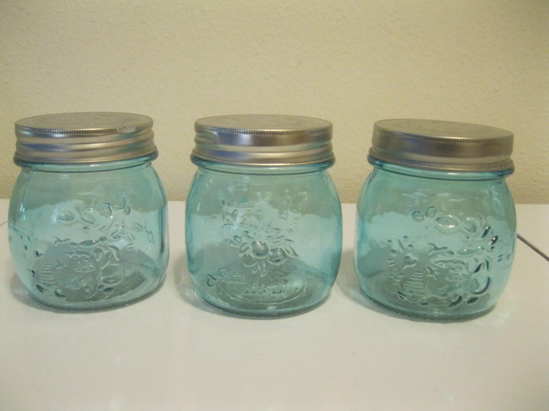 Three embossed decorative blue glass mason jars by for Designer glass jars