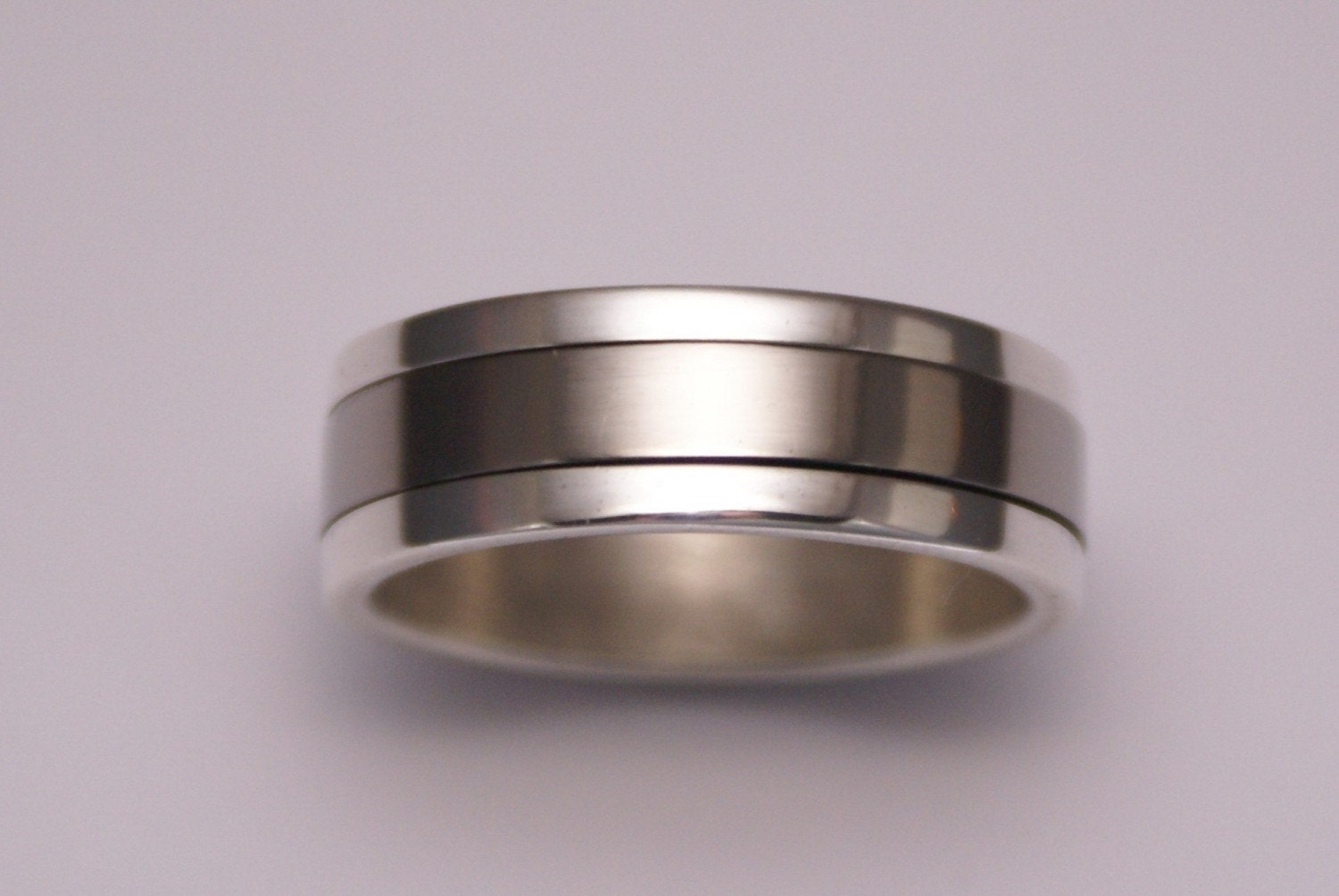 Silver And Titanium Spinning Male Wedding Ring By Tristanbrazier