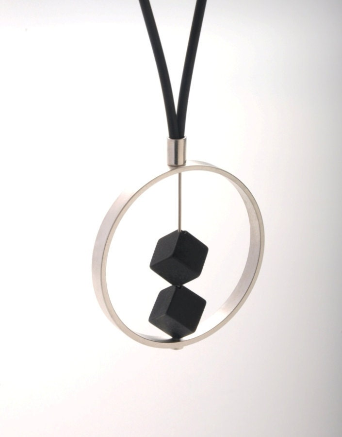 2 DARK pendant. A large palladium-plated ring with 2 black onyx , attached to a black leather necklace.