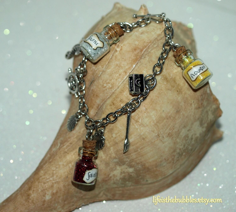 the mermaid ariel charm bracelet by lifeisthebubbles