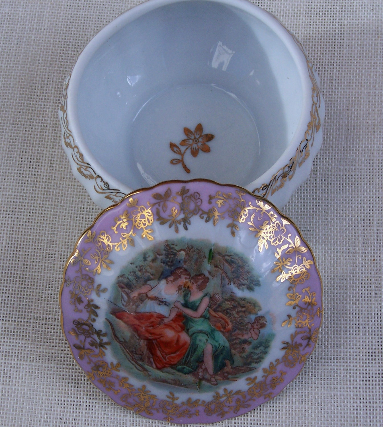 Vintage German trinket, dresser box or powder jar with romantic scene