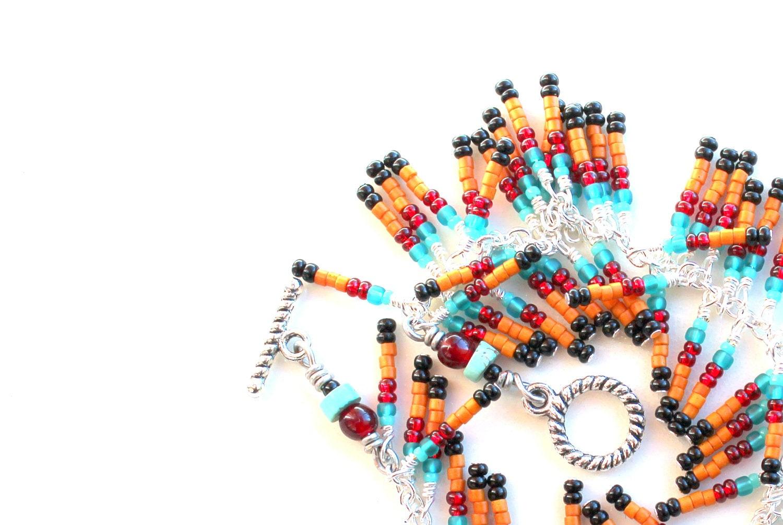 wrap bracelet. native southwestern colors seed beads  beaded bracelet. black. orange. red. teal. fringe - UniqueNecks
