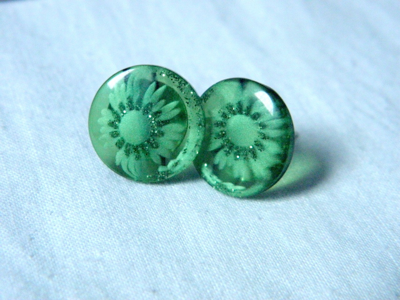 Platic button earrings green color