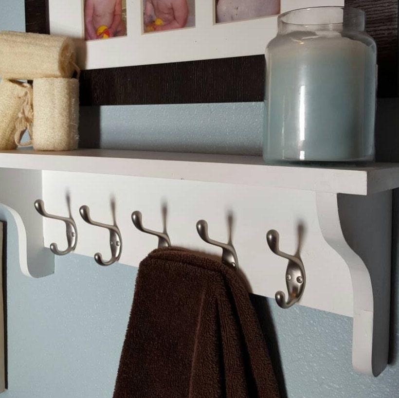Bathroom shelf with towel hooks