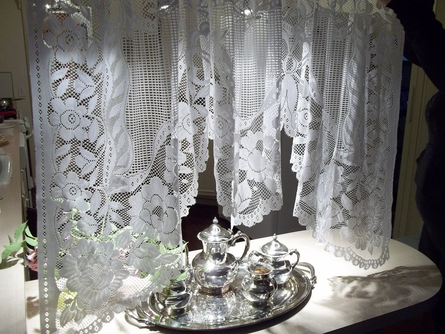 white lace curtains swag valance silhouetted by herminascottage