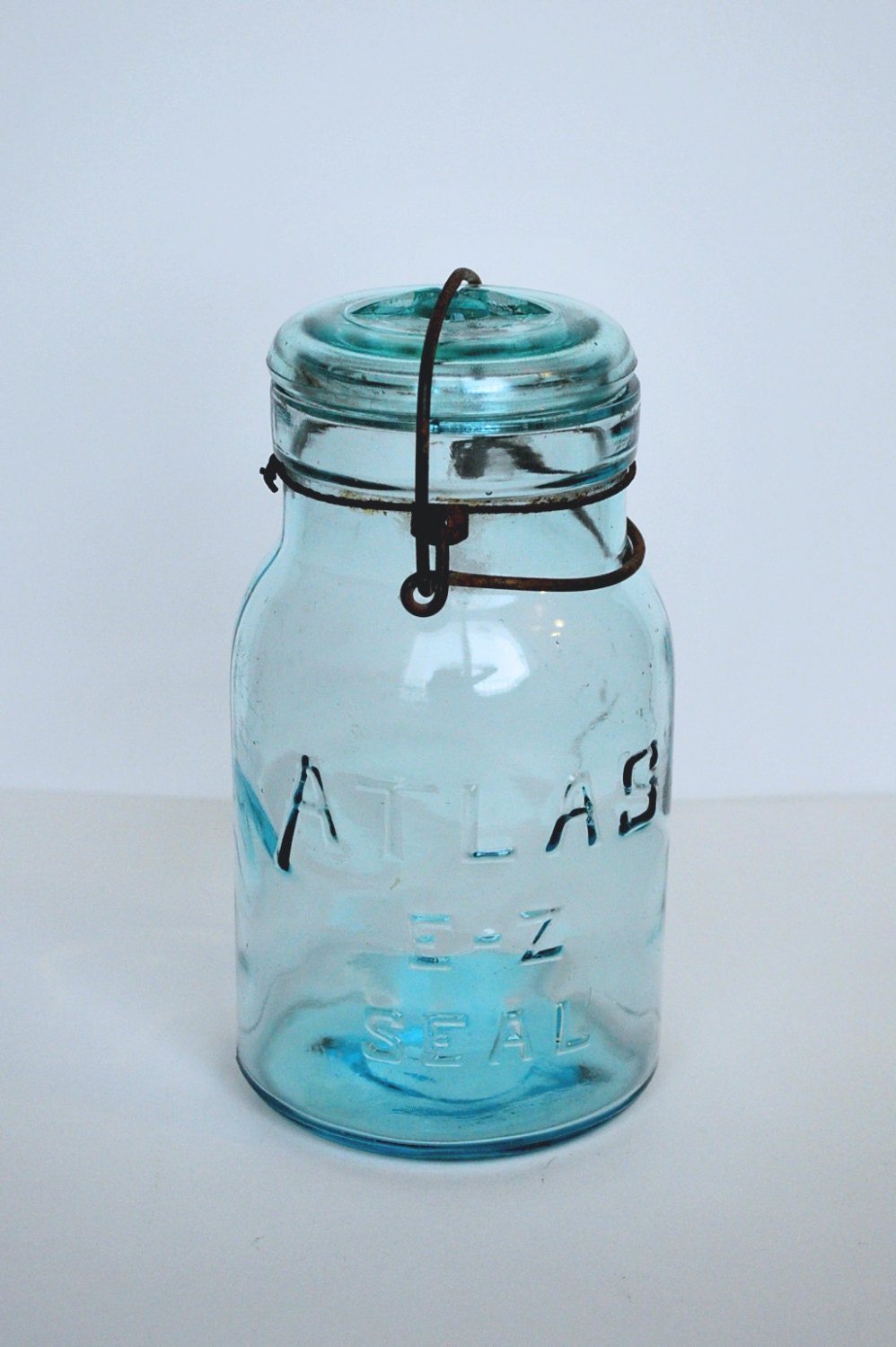 items similar to vintage atlas blue jar with glass lid and clamp on etsy. Black Bedroom Furniture Sets. Home Design Ideas