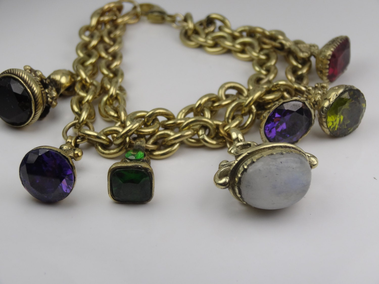 Beautiful double charm bracelet with amethyst moonstone rhodolite and more