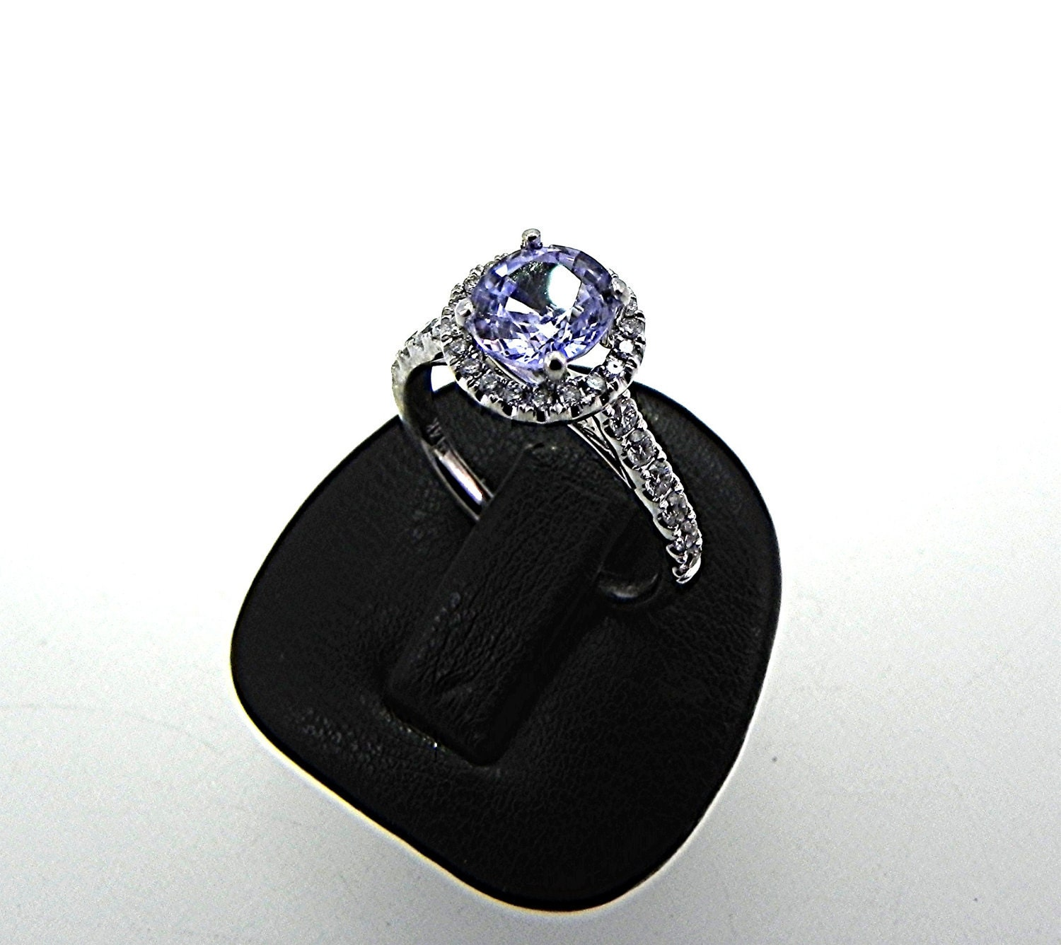 Natural Light blue Sapphire 1.30ct set in 14K white gold Halo ring with .30 carats of diamonds