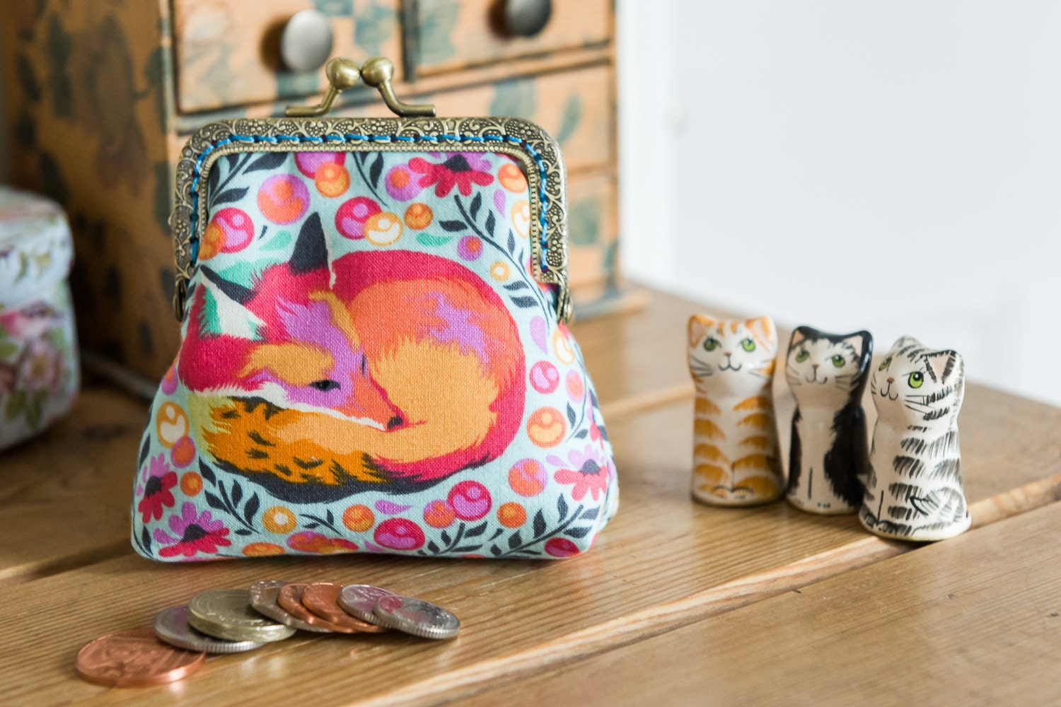 Coin purse made with Fox Nap cotton print by Tula Pink in sorbet colour with a turquoise lining  hand stitched bronze colour metal frame