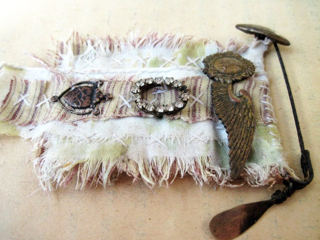 Poverty. Textile and Antiques Rustic Victorian Gypsy Assemblage Brooch. Lace fabric and rhinestones.