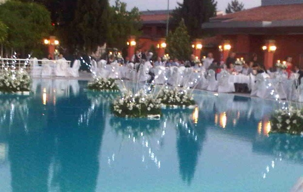 Floating flowers with lights for outdoor by for Garden pool wedding