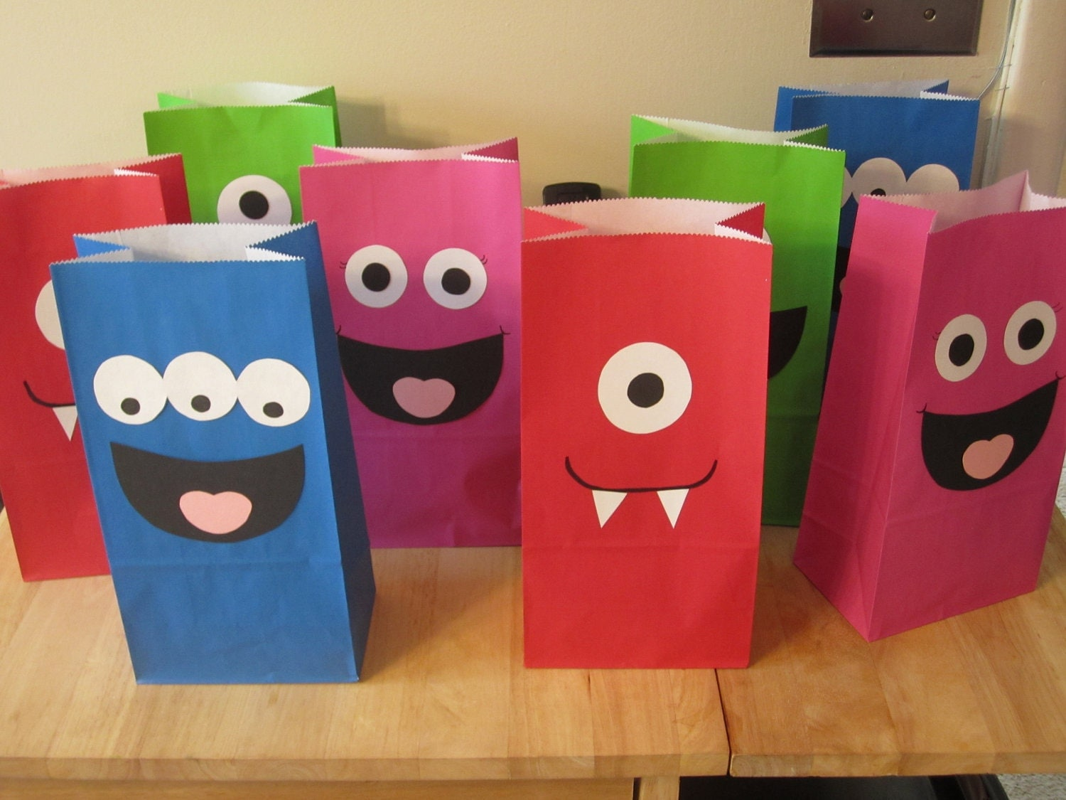 Ways to decorate gift bags - Set Of 12 Monster Birthday Party Favor Bags