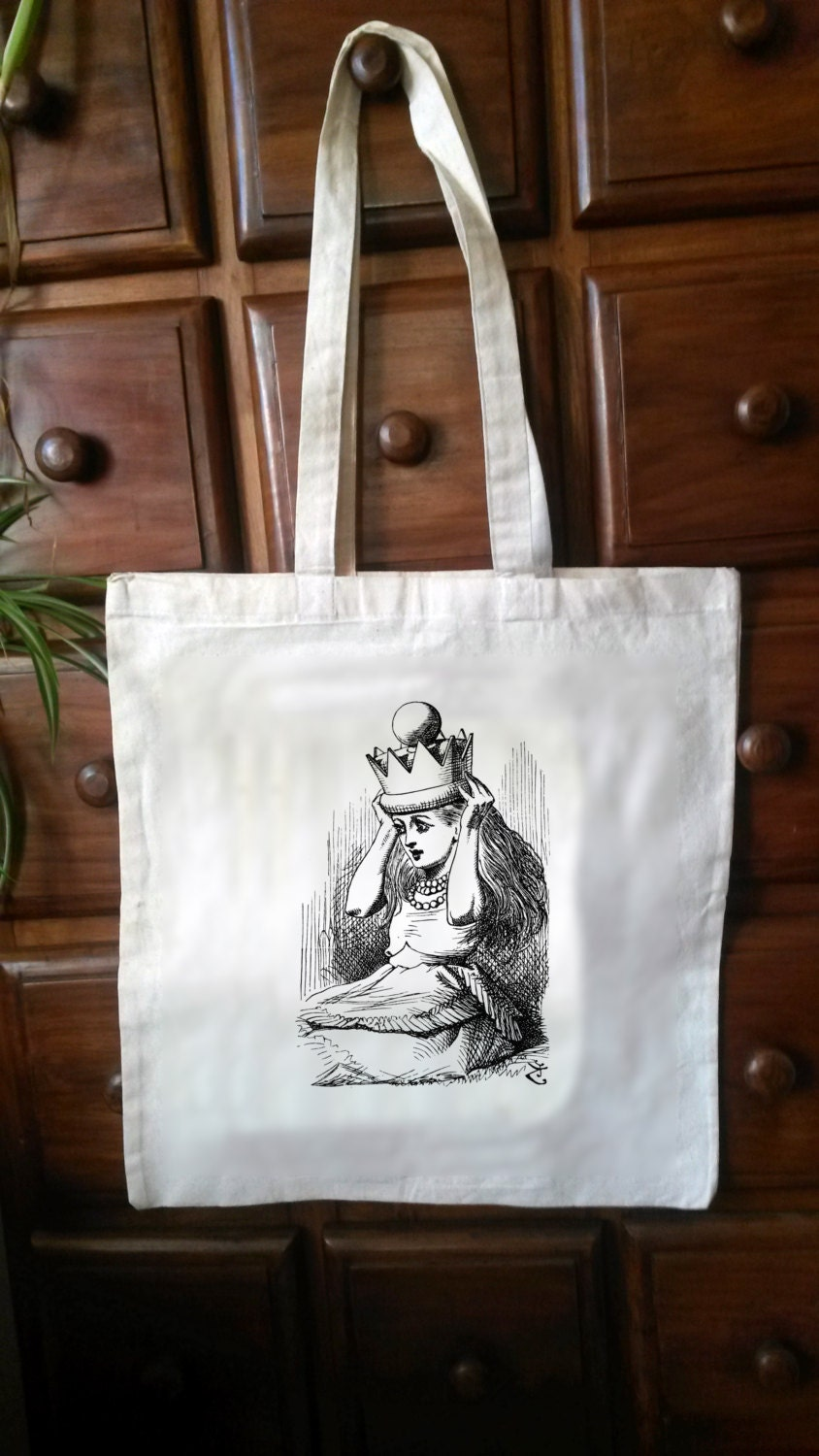 One CreamWhite Cotton Tote with an original illustration taken from the first edition of CS Lewiss Alice in Wonderland (Bag06)