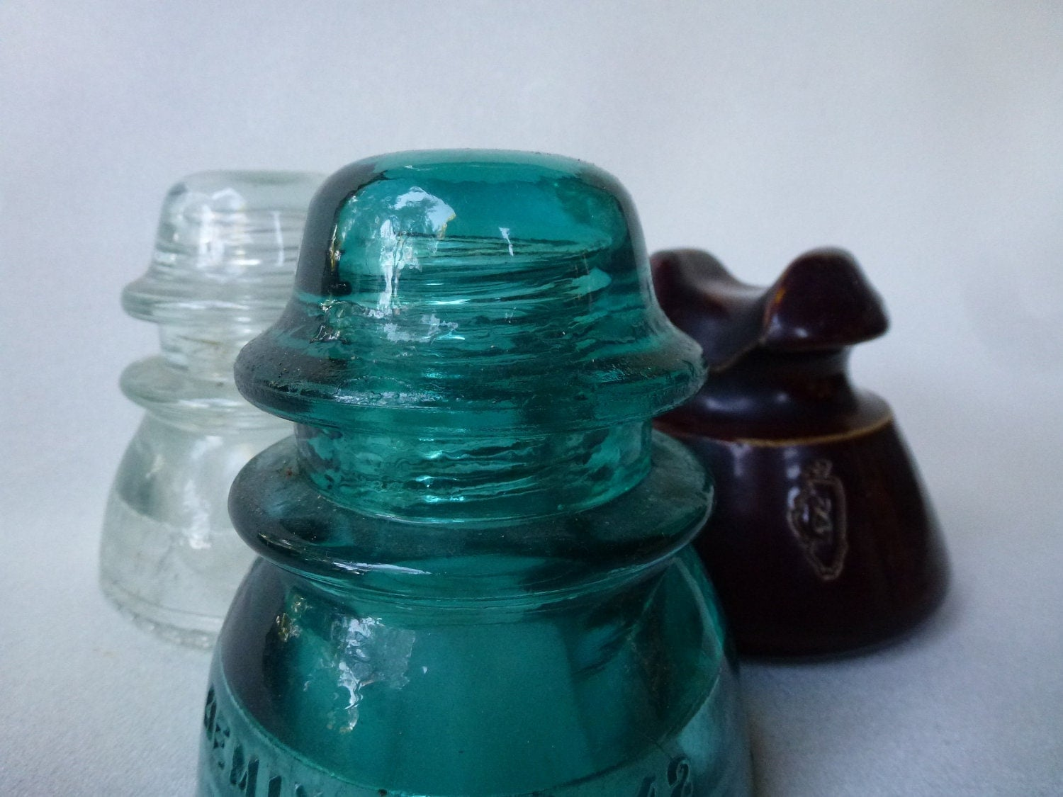 Antique glass and ceramic electrical insulators set by for Collectible glass insulators