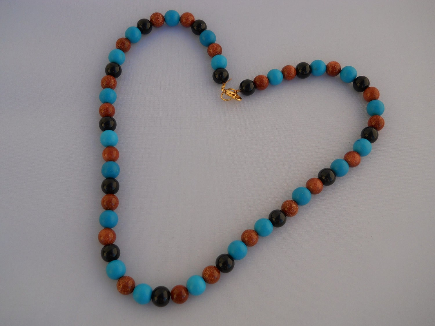 chalk turquoise, goldstone, black glass pearl necklace