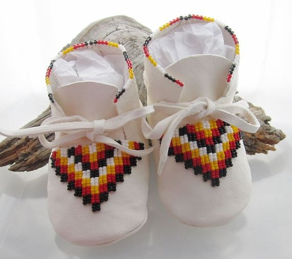 Native american deer hide baby moccasins with a traditional bead work