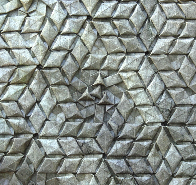 Strange symmetry - complex origami tessellation