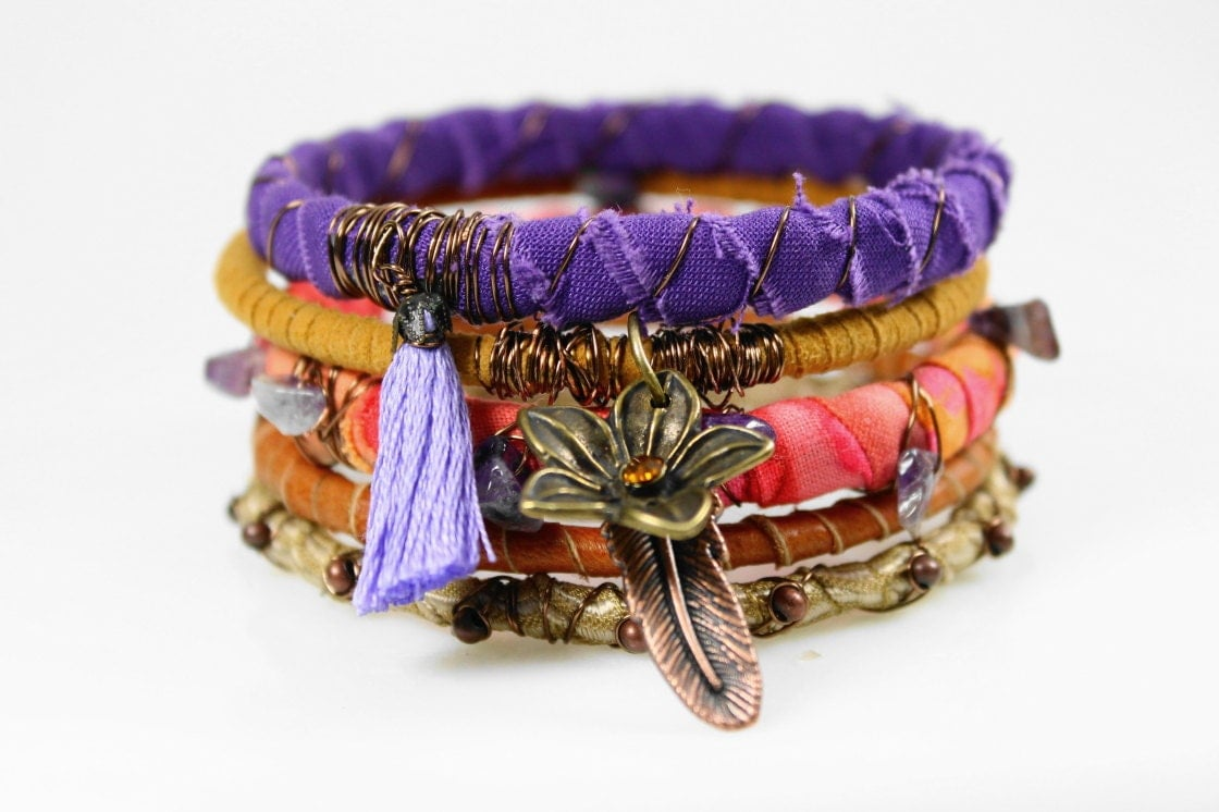 Purple orange ochre Bohemian bracelet stack, fabric bangles, rustic gypsy hippie jewelry, sari silk wrap, leather wrap charm bracelet - WrappedInLeather