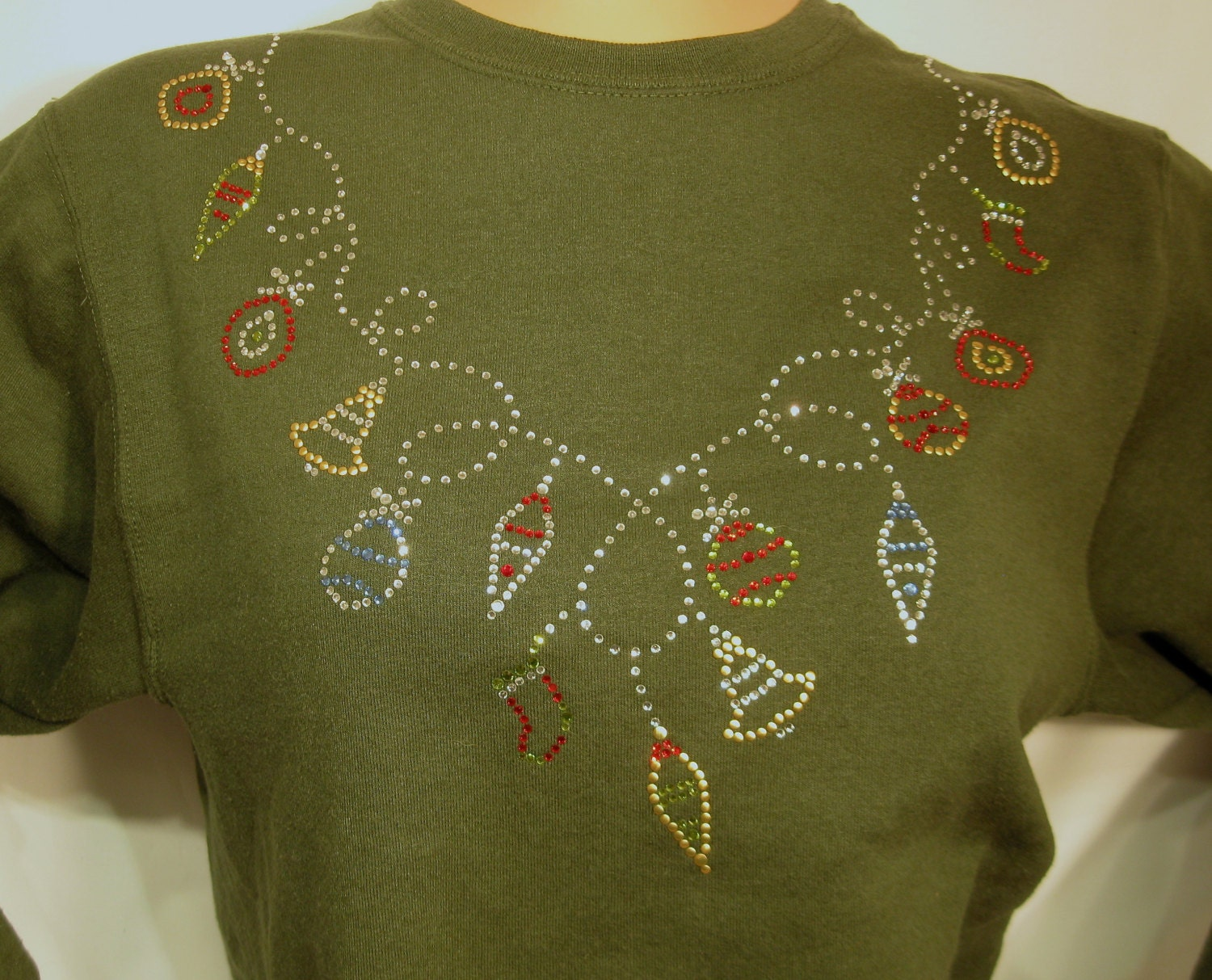 Green holiday pull over crew neck  50/50 poly- cotton blend sweatshirt.  Small thru 4x sizes available.